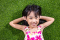 Asian Chinese Little Girl Lying On The Grass Stock Images - 94214384