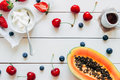 Summer Fruits. Fresh Juicy Berries And Papayaon The White Wooden Table, Top View Stock Images - 94249314