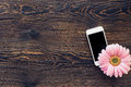 Flower And Mobile Phone With Blank Screen On Wooden Background, Top View. Mock Up Stock Photography - 94265772