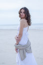 Woman Portrait On The Beach. Happy Beautiful Curly-haired Girl Full-length, The Wind Fluttering Hair. Spring Portrait On The Beach Royalty Free Stock Photos - 94268828