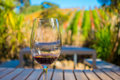 Cup Of Red Wine On Vineyard Background In Waiheke Island In Auckland, In A Beautiful Blue Sky In Summer Time Royalty Free Stock Image - 94276316
