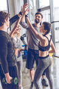 Young Athletic People In Sportswear Giving High Five In Gym Royalty Free Stock Photo - 94306925