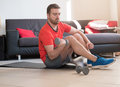 Man Doing Body Exercise And Working Out Home Stock Photo - 94309050