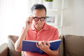 Man In Glasses Reading Book At Home Stock Photos - 94319033
