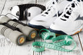 Stylish Sneakers On Wooden Surface. Time For Physical Activity. Royalty Free Stock Image - 94345736