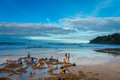 NORTH ISLAND, NEW ZEALAND- MAY 16, 2017: Tourists Digging Their Own Hot Springs In Hot Water Beach, Coromandel. 130,000 Royalty Free Stock Photo - 94346055