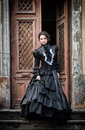 Lady In Black Standing In The Doorway Royalty Free Stock Photography - 94356927