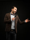 Showman With A Microphone Royalty Free Stock Images - 94357039