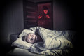 Scared Boy Lying In The Bed While The Masked Stranger Royalty Free Stock Photography - 94357217
