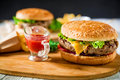 Classic Big Hamburger With Beef, Sauce And French Fries On Dark Background. American Tasty Food Royalty Free Stock Photography - 94366217