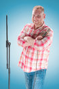 Studio Portrait Of A Young Showman With The Microphone Royalty Free Stock Photo - 94374475