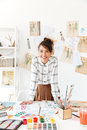 Smiling Professional Woman Designer Leaning At Her Work Desk Royalty Free Stock Image - 94379596
