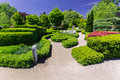 Gorgeous Inviting View Of Botanical Garden Landscape On Sunny Spring Day With People Walking In Background Royalty Free Stock Image - 94382576