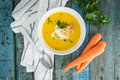 Carrot Soup With Cream And Parsley On Wooden Background Royalty Free Stock Images - 94420839