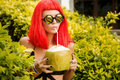 Girl With Red Hairs Drink Cold Coconut Juice. Stock Images - 94444764