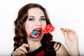 Smiling Girl With Braces Holding Heart Candy Posing On A White Background Royalty Free Stock Image - 94453386