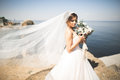 Romantic Beautiful Bride In White Dress Posing On The Background Sea Royalty Free Stock Photography - 94460807