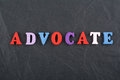 ADVOCATE Word On Black Board Background Composed From Colorful Abc Alphabet Block Wooden Letters, Copy Space For Ad Text Stock Image - 94464941