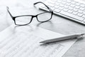 Business Report Preparing With Calculator And Glasses On Office Background Stock Image - 94481961