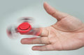 Red Hand Spinner Royalty Free Stock Photo - 94482625
