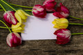 Bouquet Of Tulip Flowers And Blank Notepad On Rustic Wooden Background Royalty Free Stock Photo - 94492025