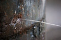Rusty Burst Pipe Spraying Water After Freezing In Winter. Stock Image - 94500011