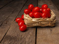 Organic Grape Tomatoes On A Wooden Table Royalty Free Stock Photo - 94503235