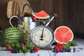 Watermelon Berries On Vintage Scale Stock Photos - 94577233