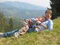 Child And Mother Play On Grass Stock Images - 9462644