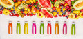 Variety Of Colorful Smoothies And Juices Beverages In Bottles With Various Fresh Organic Fruits And Berries Ingredients On White W Stock Image - 94601671