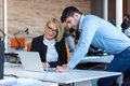 Colleagues Chatting, Sitting Together At Office Table, Smiling Royalty Free Stock Photography - 94675007