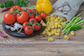 Italian Food Cooking Ingredients On Wooden Background, Dry Pasta, Vegetables, Fresh Tomatoes, Asparagus, Bell Pepper Stock Photo - 94713020