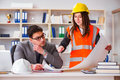 The Construction Foreman Supervisor Reviewing Drawings Stock Photos - 94781463