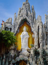 White Guan Yin Statue In The Stone Royalty Free Stock Photos - 94795348