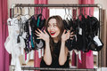 Happy Woman Standing In Clothes Shop Indoors Choosing Lingerie Stock Image - 94863561