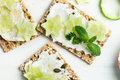 Snack From Wholegrain Rye Crispbread Crackers And Cucumber Royalty Free Stock Image - 94941686