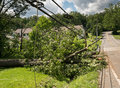Snapped And Downed Power Post And Line After Storm Stock Image - 94987741