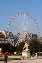 Big Wheel And Statue Royalty Free Stock Image - 951216