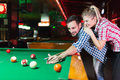 Young Couple Playing Together Pool In Bar Stock Photos - 95064753