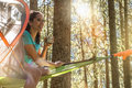 Happy Woman Relaxing In Hanging Tent Camping In Forest Woods During Sunny Day.Group Of Friends People Summer Adventure Royalty Free Stock Image - 95100866