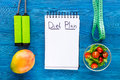 Tasty Food For Slimming. Notebook For Diet Plan, Salad, Fruits And Measuring Tape On Blue Table Top View Mock Up Royalty Free Stock Images - 95103479