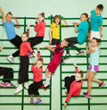 Happy Kids Exercising On Wall-mounted Gym Ladder Royalty Free Stock Photo - 95109195