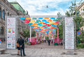 People On Alley Of Soaring Umbrellas In St. Petersburg. Russia Stock Images - 95140244