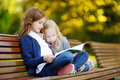 Adorable Little Schoolgirls Studying Outdoors On Bright Autumn Day. Young Students Doing Their Homework. Education For Small Kids. Royalty Free Stock Image - 95157266