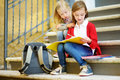 Adorable Little Schoolgirls Studying Outdoors On Bright Autumn Day. Young Students Doing Their Homework. Education For Small Kids. Stock Images - 95157644