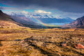 Light Rain And The Rainbow In The Icelandic Mountains. Stock Photos - 95202393