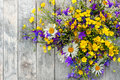 Wooden Background With A Bouquet Of Small Wild Flowers Daisies, Bells . Stock Images - 95355904