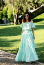 Young Beautiful Woman In A Light Green Pastel Long Dress Is Walk Stock Photography - 95420802