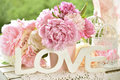Love Decoration With Wooden Letters And Peony Flowers With Color Stock Images - 95441424