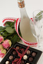 Bunch Of Roses, Champagne Bottle, Wine Glasses And Assorted Chocolate Box Stock Photo - 95458820